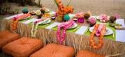 Гавайские леи,  Гавайские юбки,  шоколадные фонтаны,  фруктовые пальмы.